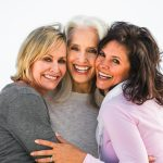 Three smiling mature women