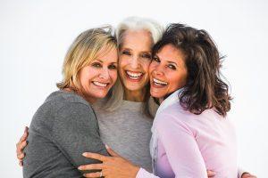 Three smiling mature women