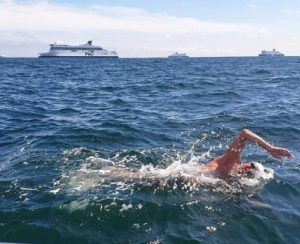 Andrew Butler swimming for charity